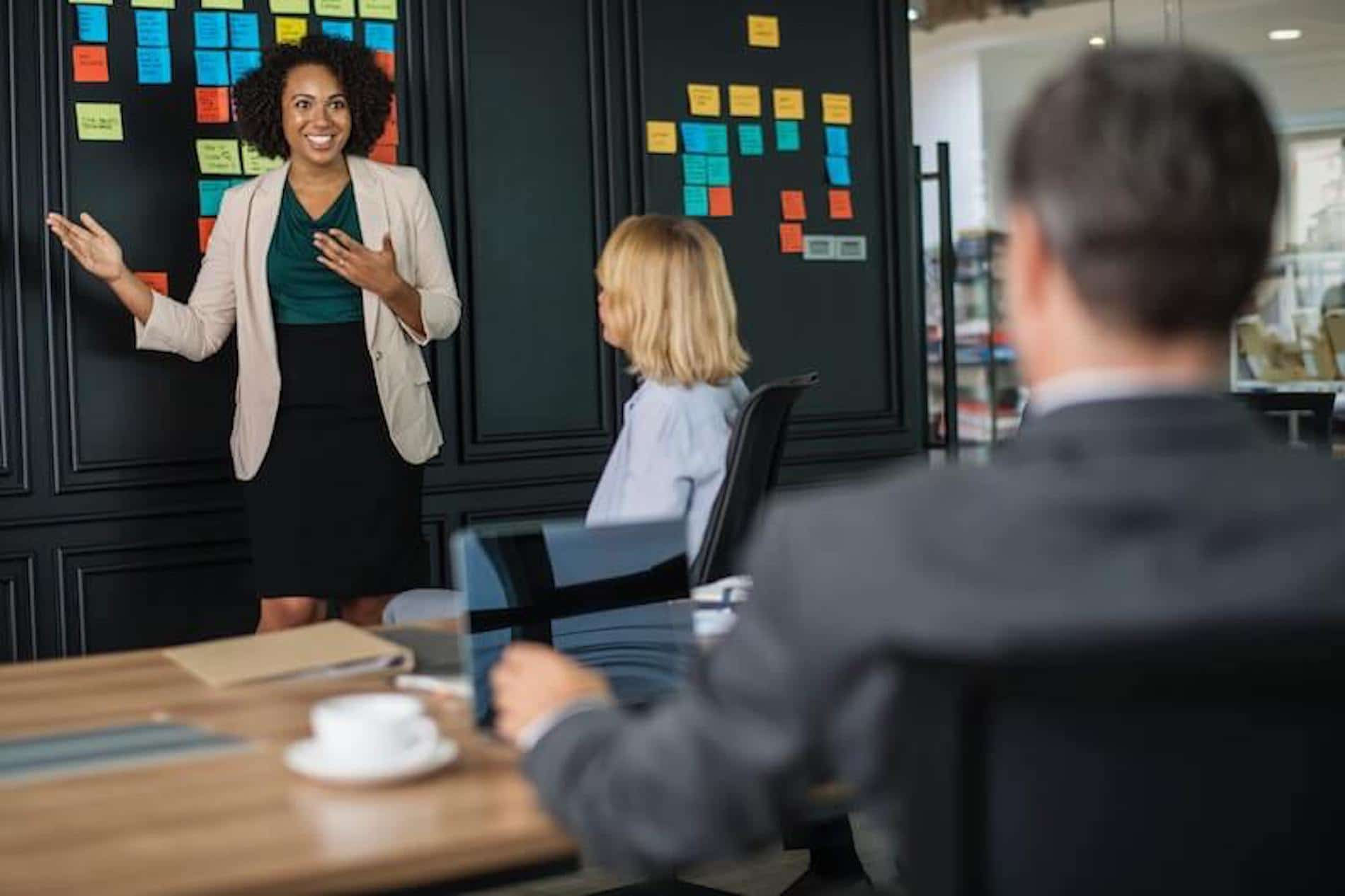 Woman confidently using fearless presentations public speaking training